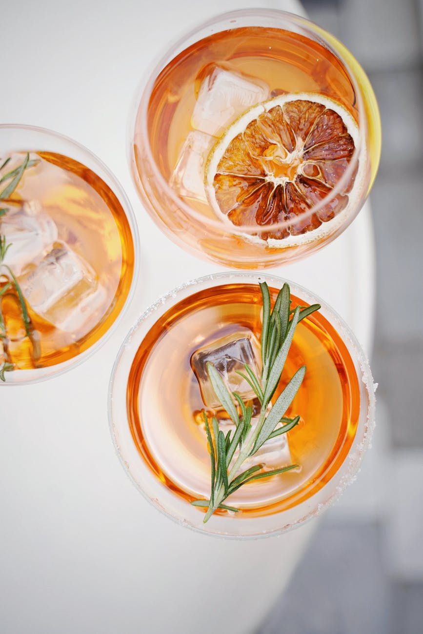 sliced orange fruit in clear drinking glass