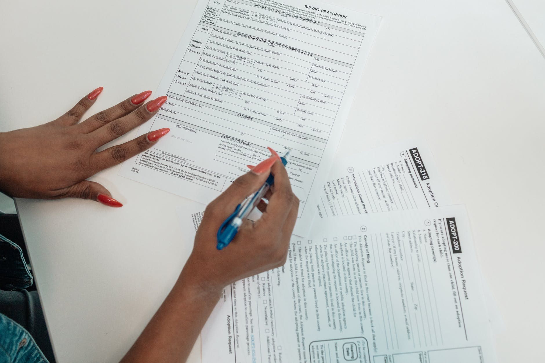 a person filling out adoption request documents